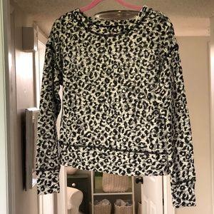 Cream and black leopard print knit sweatshirt